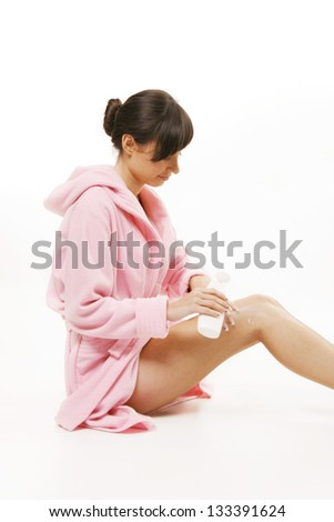 Young woman with a pink bathrobe