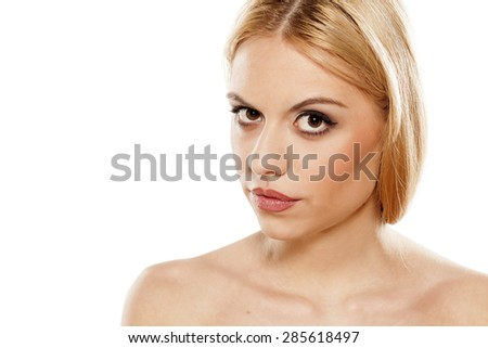 young woman with a raised eyebrow and distrustful gesture