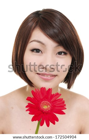 young woman with a red flower - stock photo