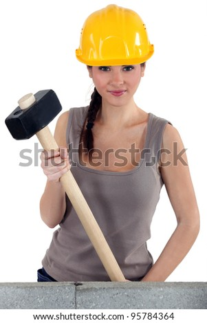 Young woman with a sledgehammer - stock photo