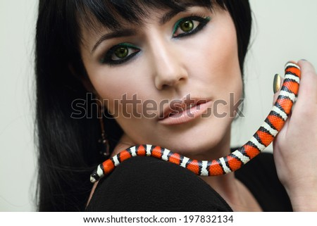Young woman with a snake. - stock photo