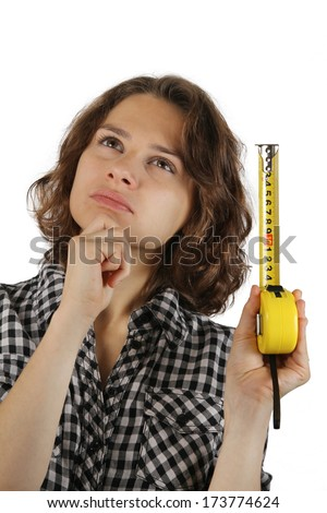 young woman with a tape measure thinking of renovating