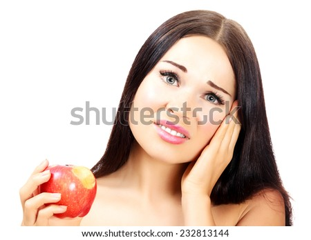 Young woman with a toothpain, white background, copyspace - stock photo