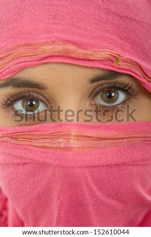 young woman with a veil, close up portrait, studio picture - stock photo