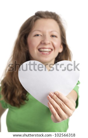 Young woman with a white paper-heart - stock photo