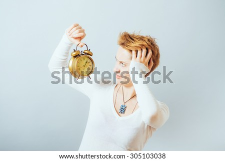 Young woman with alarmclock  - stock photo