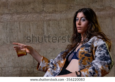 young woman with alcoholic drink
