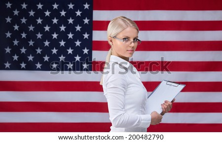 Young woman with an American flag - stock photo