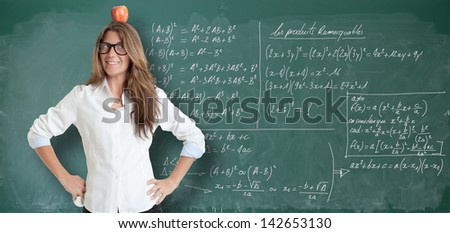 Young woman with an apple in her head, by a blackboard full of formulae