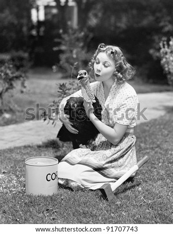 Young woman, with an ax next to her, hugs a turkey
