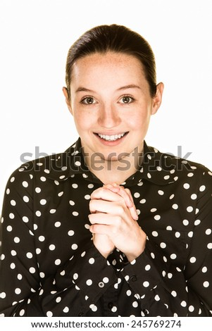 Young woman with an expression of genuine hope - stock photo