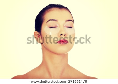 Young woman with an eye mask - stock photo