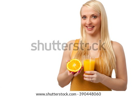 Young woman with an Orange and Orange Juice - stock photo