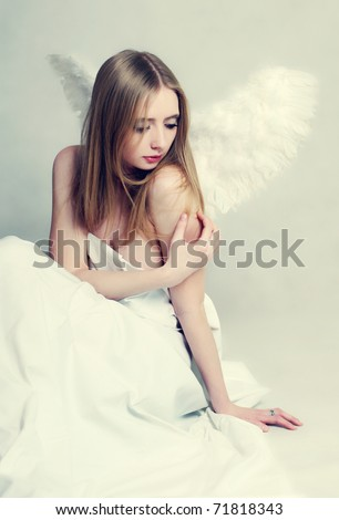 Young woman with angel wings - stock photo