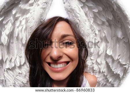 Young woman with angel wings isolated on white taken with fish eye lens