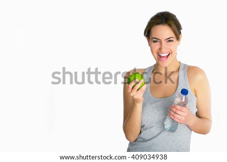 young woman with apple and water