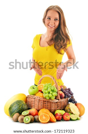 Young woman with assorted fruits isolated on white background