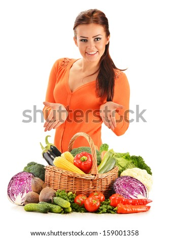 Young woman with assorted vegetables isolated on white background