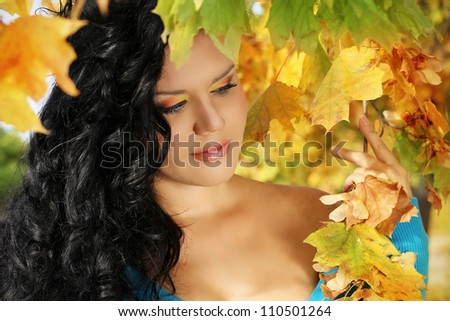 Young woman with autumn leaves fall yellow maple garden background - stock photo