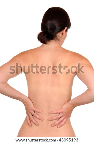Young woman with backache in front of a white studio background