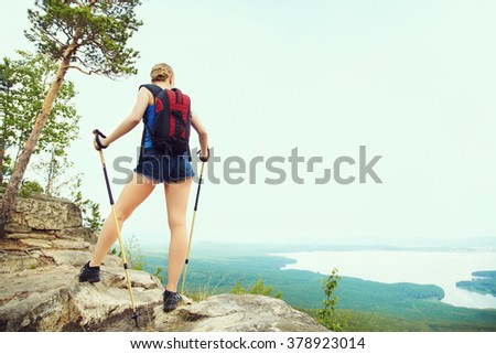 young woman with backpack hiking in the mountains. people outdoors. healthy lifestyle