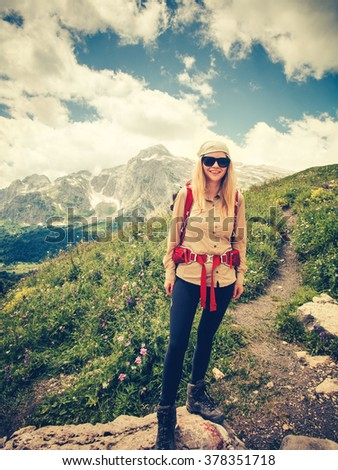 Young Woman with backpack trekking Travel Lifestyle concept Summer journey vacations outdoor mountains on background