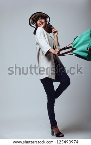 Young woman with bag - stock photo