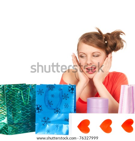 young woman with bags isolated on white