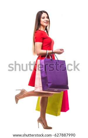 Young woman with bags, shopping concept, isolated on white background