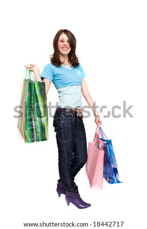 Young woman with bags shopping for Christmas, isolated on white