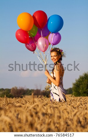 young woman with balloons outdoor - stock photo