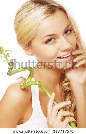 young woman with bamboo isolated on white - stock photo