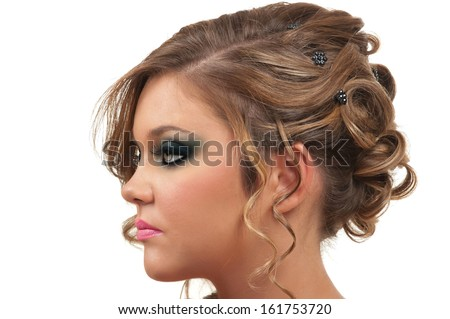 Young woman with beautiful hair do and smokey eye make up - stock photo