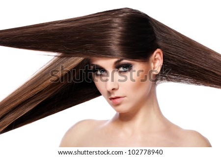 Young woman with beautiful hair over white bakcground - stock photo