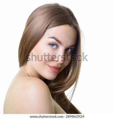 Young woman with beautiful healthy face and long fair hair. Health care, skin care, beauty treatment, cosmetology, youth and aging concept.