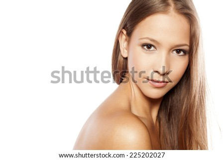 Young woman with beautiful healthy face on white background