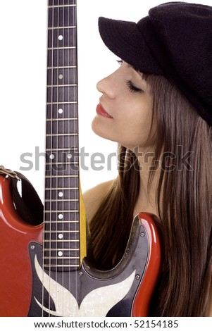 Young woman with beret hat holding red electric guitar