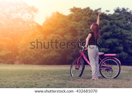 Young woman with bicycle in morning. healthy and lifestyle concept.