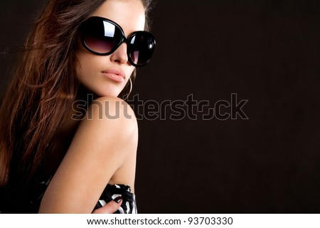 young woman with big fashion sunglasses portrait - stock photo