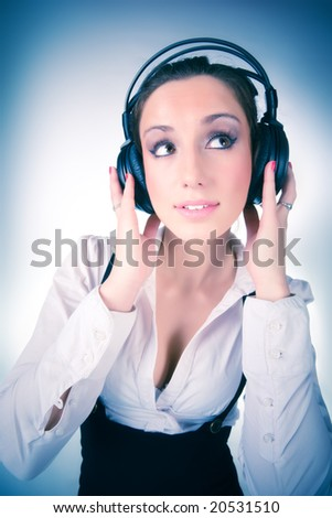 Young woman with big headphones. On soft blue tint.