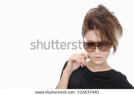 Young woman with big sunglasses-close up. Hairstyle