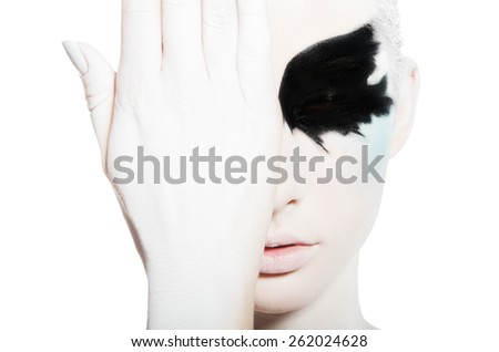young woman with black and white face art isolated on white