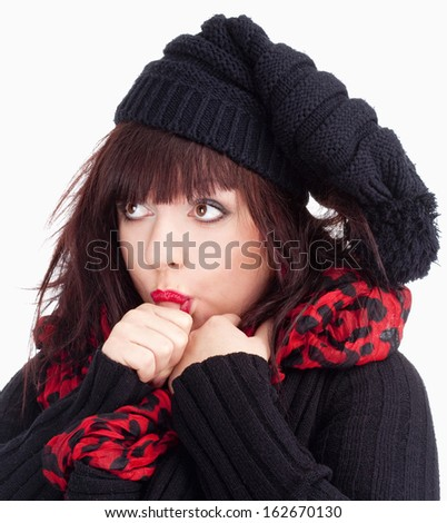 Young Woman with Black Cap Sucking on her Thumb - Isolated on White  - stock photo