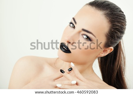 young woman with black lips and black and white nails, beauty portrait