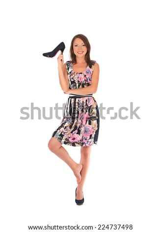 Young woman with black shoes, studio isolated on white - stock photo