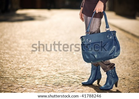 Young woman with blue handbag and shoes - stock photo