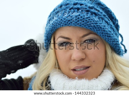 Young woman with blue hat