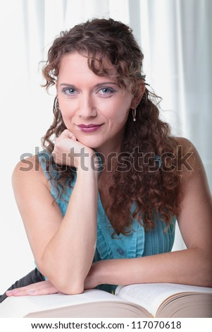 Young woman with book on white background. - stock photo