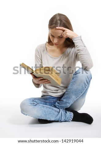 Young woman with book on white background
