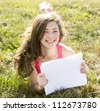 Young woman with books in summer park - stock photo